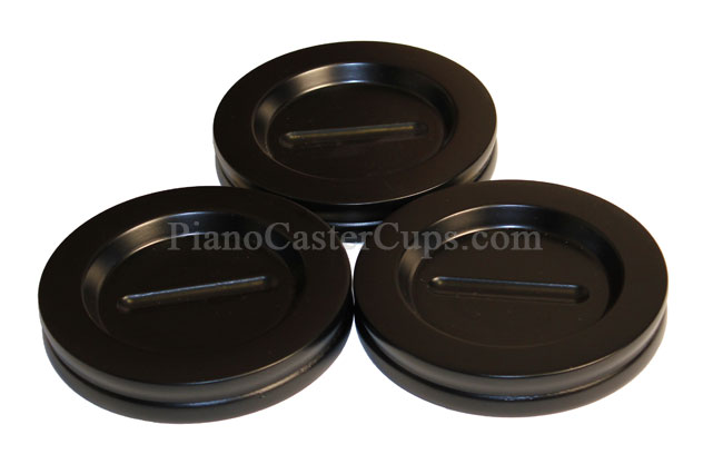 three grand piano caster cups with black satin finish